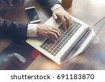 businessman working on their... | Shutterstock . vector #691183870