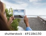 woman use digital tablet taking ... | Shutterstock . vector #691186150