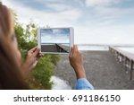 woman use digital tablet taking ... | Shutterstock . vector #691186150