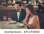 beautiful couple in a restaurant | Shutterstock . vector #691193830