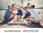 happy friends eating fruits and ... | Shutterstock . vector #691195234