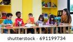 asian teacher teach in... | Shutterstock . vector #691199734