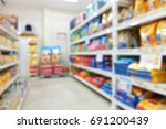 Stock photo pet food package on shelf in shop feed or pet food store abstract blurred background 691200439