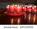 fire light from red candle... | Shutterstock . vector #691210933