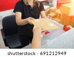 male hand send mail envelope to ... | Shutterstock . vector #691212949
