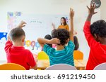 preschool kid raise arm up to... | Shutterstock . vector #691219450