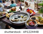oyster and champagne happy hour ...   Shutterstock . vector #691224448