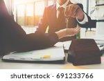 estate agent giving house keys... | Shutterstock . vector #691233766