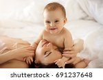 young happy mother and her baby ... | Shutterstock . vector #691237648