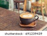 hot latte coffee with latte art ...   Shutterstock . vector #691239439