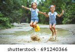happy funny sisters twins ... | Shutterstock . vector #691240366