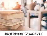 Small photo of books stack on the library table. At the time of university student exams in selective focus.