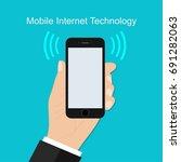 hand holding mobile phone in... | Shutterstock .eps vector #691282063