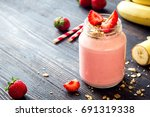 strawberry and banana smoothie... | Shutterstock . vector #691319338