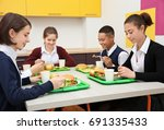 children sitting at table in... | Shutterstock . vector #691335433