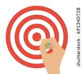the hand holds a dart dart. the ... | Shutterstock .eps vector #691340728