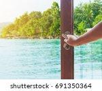 women hand open door to the... | Shutterstock . vector #691350364