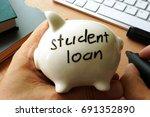 student loan written on a piggy ...   Shutterstock . vector #691352890