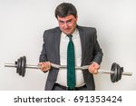 young businessman with barbell