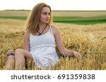 beautiful girl in a white dress ...   Shutterstock . vector #691359838