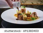 beautiful and tasty food on a... | Shutterstock . vector #691383403