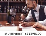 two sommeliers  male and female ... | Shutterstock . vector #691398100