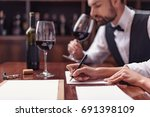 two sommeliers  male and female ... | Shutterstock . vector #691398109