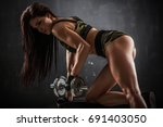 brutal athletic woman pumping... | Shutterstock . vector #691403050