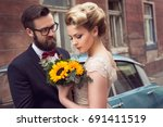 newlywed couple standing in the ... | Shutterstock . vector #691411519