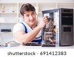computer repairman repairing... | Shutterstock . vector #691412383