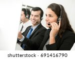 beautiful female telemarketing... | Shutterstock . vector #691416790