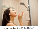 portrait of woman taking shower | Shutterstock . vector #691418548