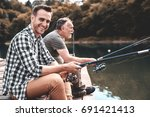 they are geared to catch fish  | Shutterstock . vector #691421413