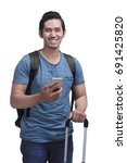 young asian man tourist holding ... | Shutterstock . vector #691425820