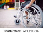 a girl with a broken leg sits... | Shutterstock . vector #691441246