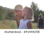 two little sisters walking in a ...   Shutterstock . vector #691444258