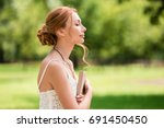 side view of beautiful young... | Shutterstock . vector #691450450