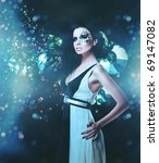 Black splatter woman in dress and rhinestones on dark background - stock photo