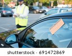 police officer giving a ticket... | Shutterstock . vector #691472869