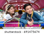 young asian couple tourists... | Shutterstock . vector #691475674