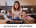 mom with her son and daugher... | Shutterstock . vector #691478800