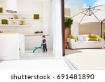 a toddler baby walking with go... | Shutterstock . vector #691481890