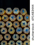 Small photo of Blunt pencils arranged in abstract patterns