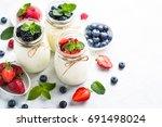 fresh homemade yogurt with... | Shutterstock . vector #691498024