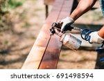 worker hands in carpentry... | Shutterstock . vector #691498594