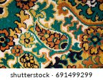 the pattern of the old carpet | Shutterstock . vector #691499299