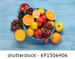 variety of fruits on the blue... | Shutterstock . vector #691506406