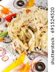 Small photo of pasta, alfredo, dinner and food concept - Alfredo pasta