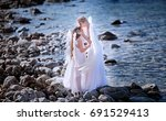 angels. mom and daughter with...   Shutterstock . vector #691529413
