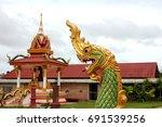 serpent statue in laos temple. | Shutterstock . vector #691539256